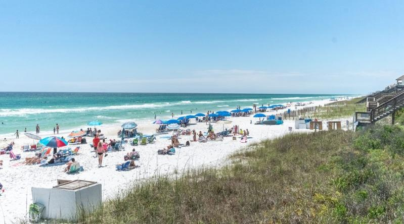 People paying on the white sand beach at Seacrest